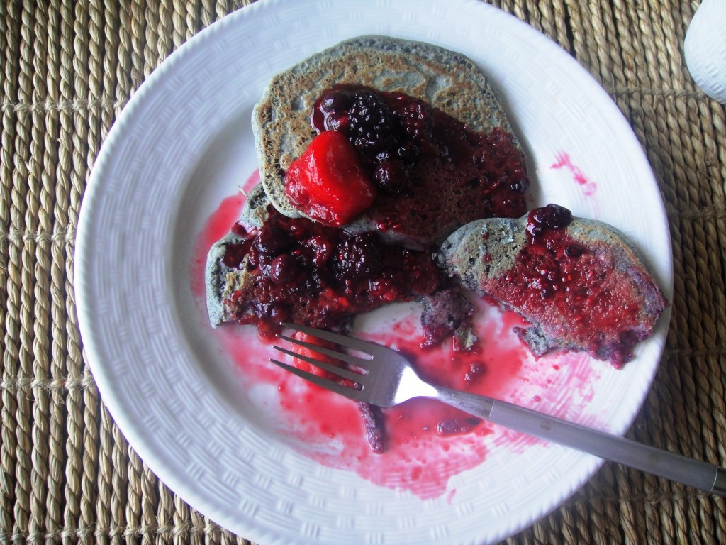 blue corn pancakes half eaten on plate