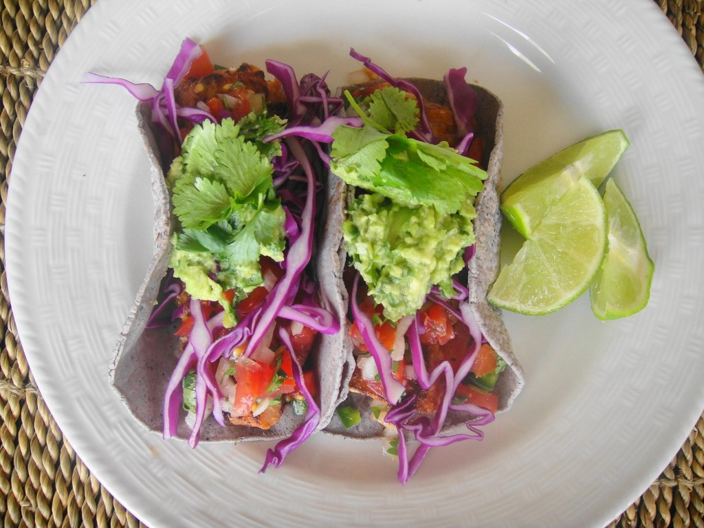 fish tacos plated with limes
