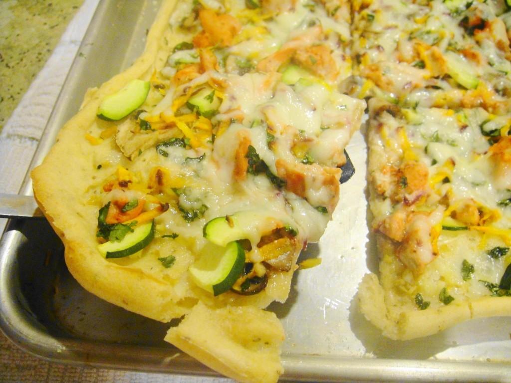 slice of tandoori chicken pizza