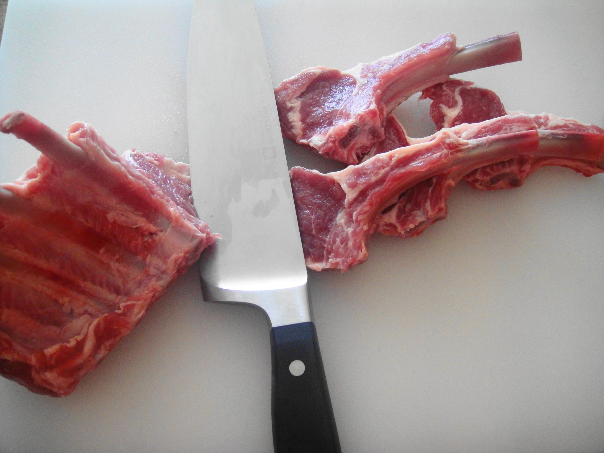 slicing lamb rack with knife
