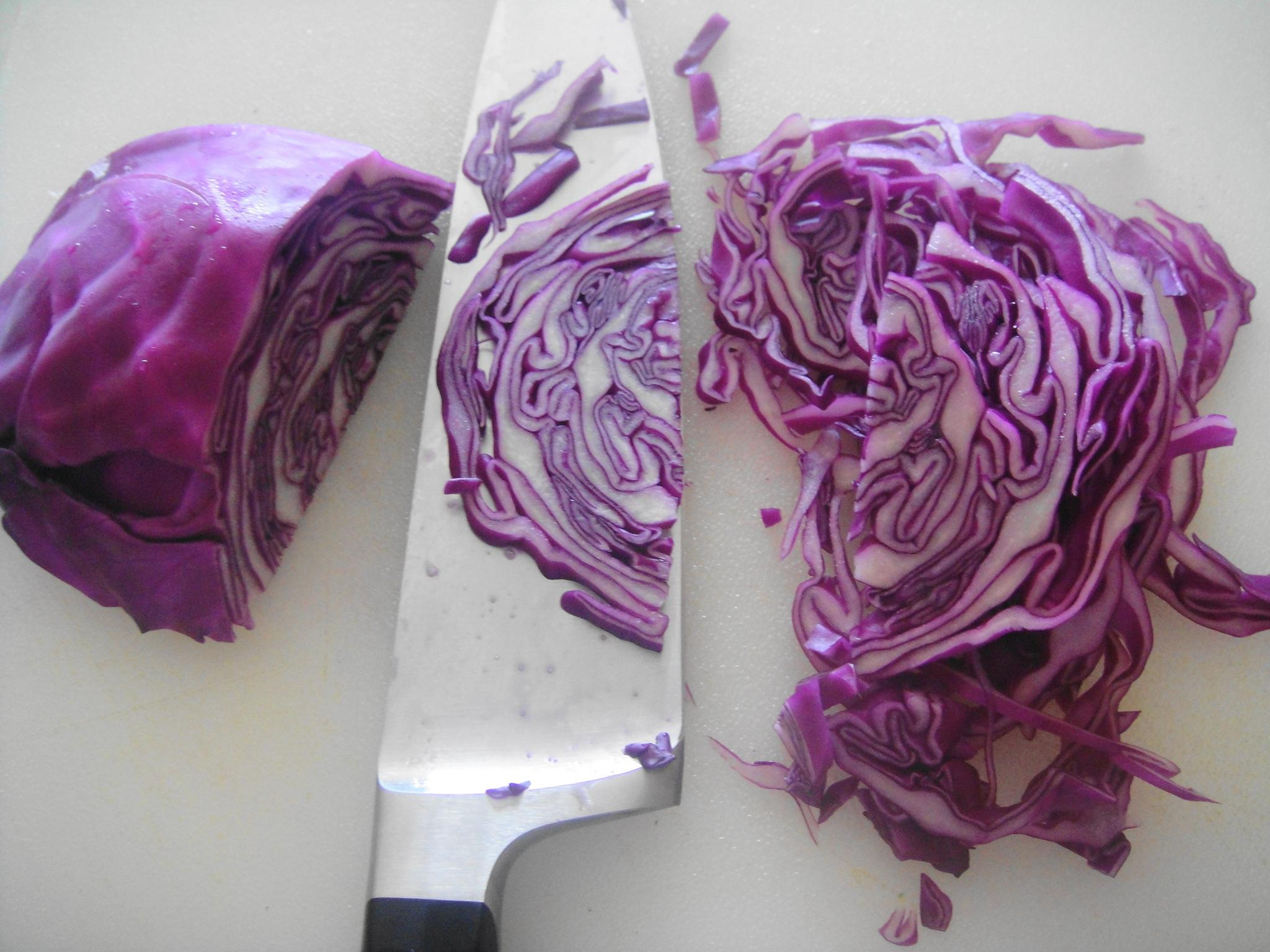 slicing purple cabbage with knife