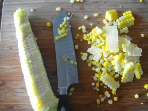 cutting corn on board