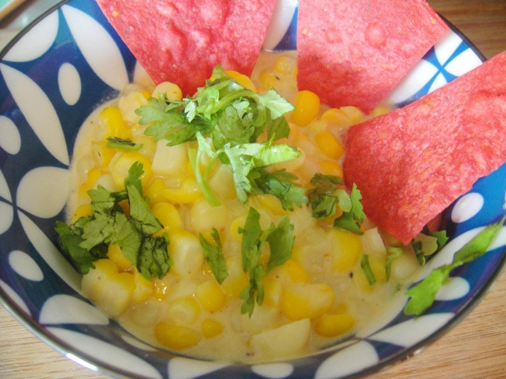 elote in blue bowl and red chips