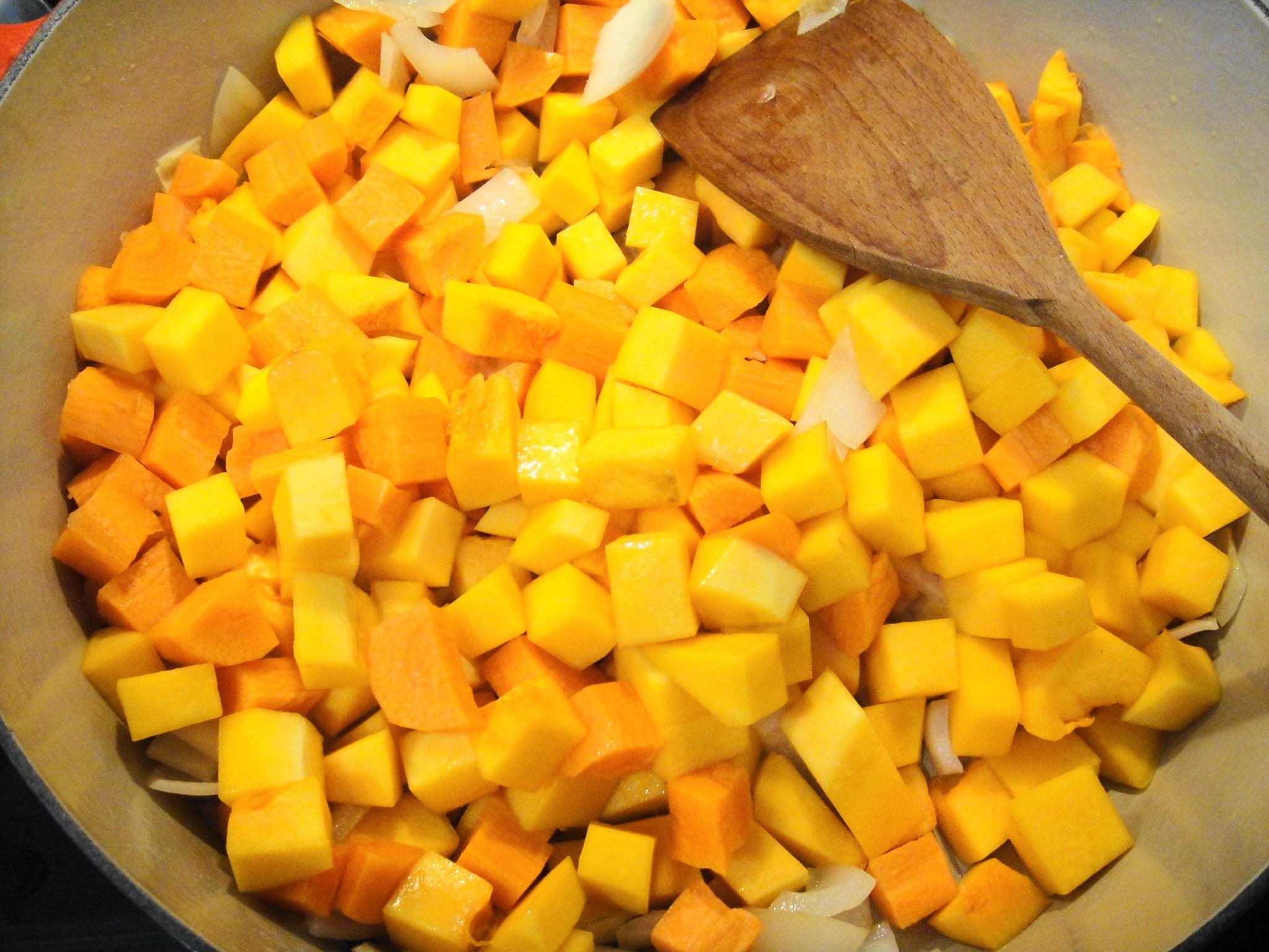 squash carrots in pot